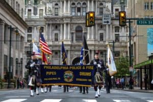 Philadelphia Police and Fire drum corp march in the Veterans Day parade