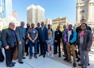 Group of young people standing with Council President Clarke, Councilman Mark Squilla, and Councilman David Oh at Solarize Philly Launch