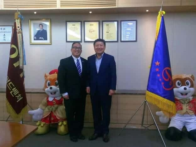 Councilmember David Oh standing with an DONG-KEE PARK, PRESIDENT OF LOTTE WORLD ADVENTURE